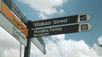 238440898-desmond-tutu-nelson-mandela-soweto-signpost